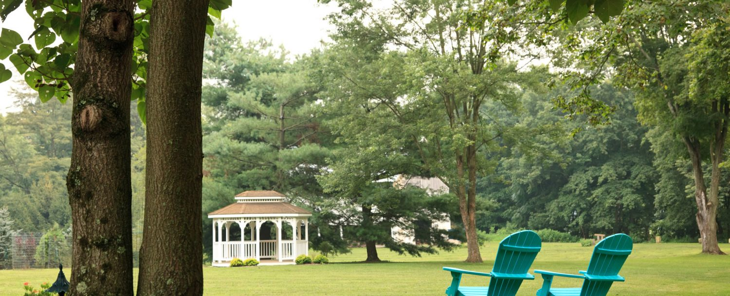 Adirondack chairs with lawn and gazebo