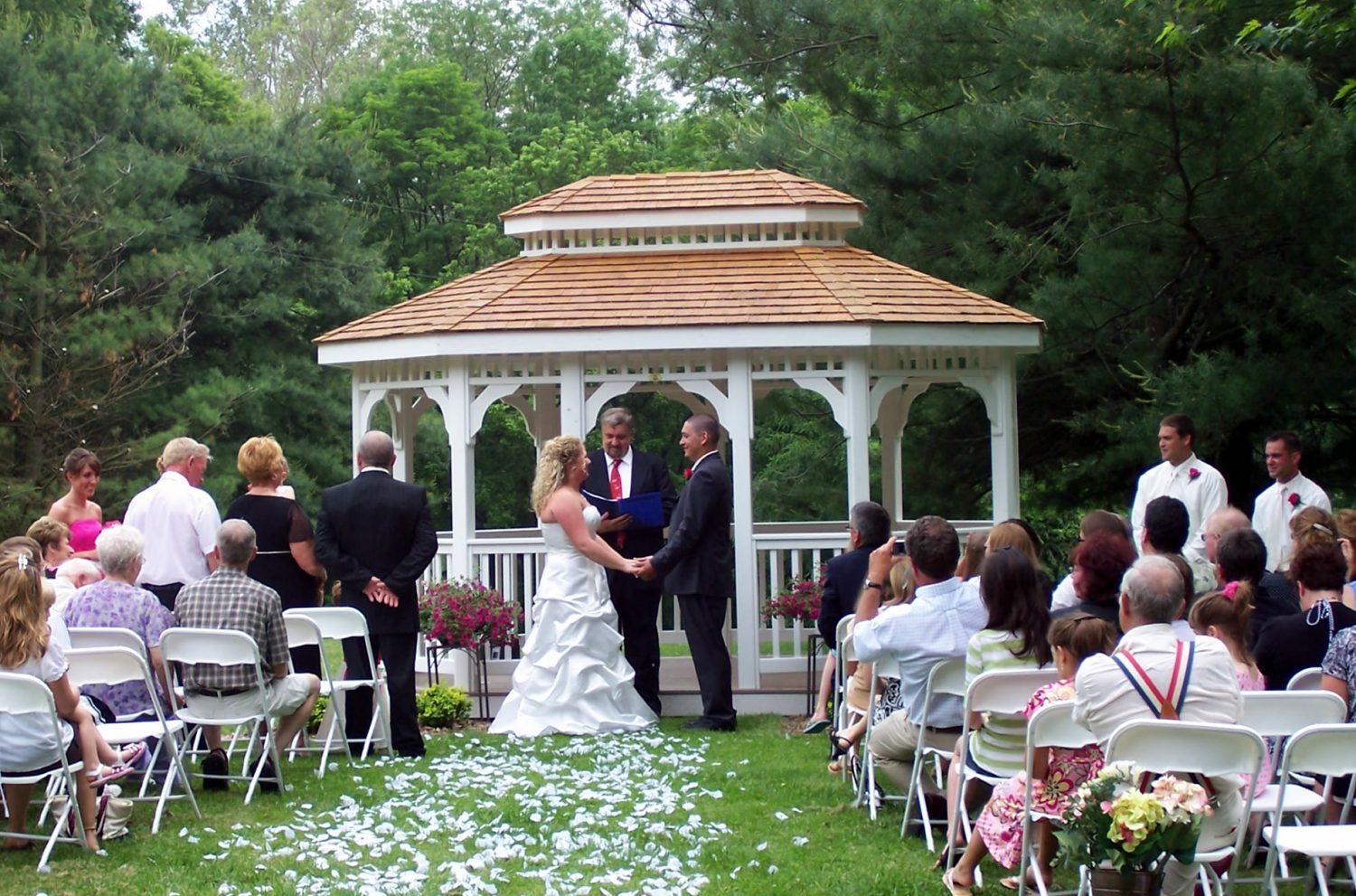 couple at altar in front of gazebo