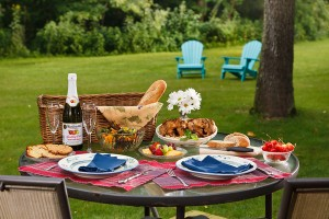 picnic basket and goods on outdoor table