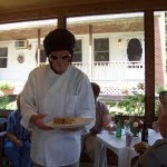 elvis lookalike serving sandwiches