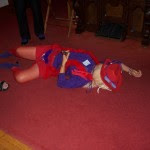 woman superhero lying on ground