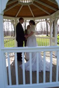 couple getting married under gazebo