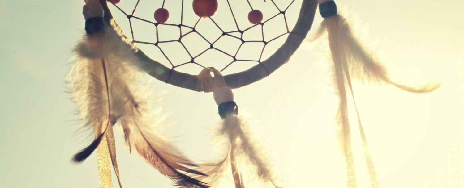 Photo of a dreamcatcher with the title and dates of the event.