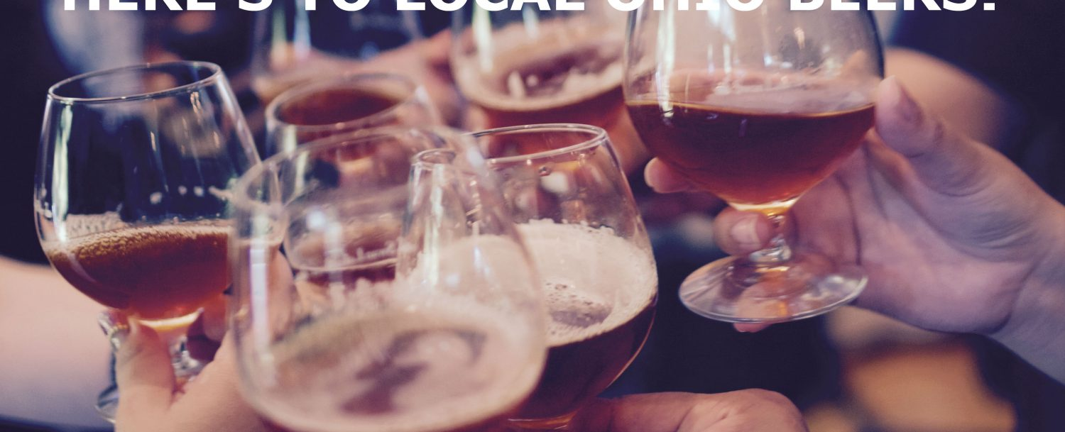 A photo of several hands toasting glasses of beer.