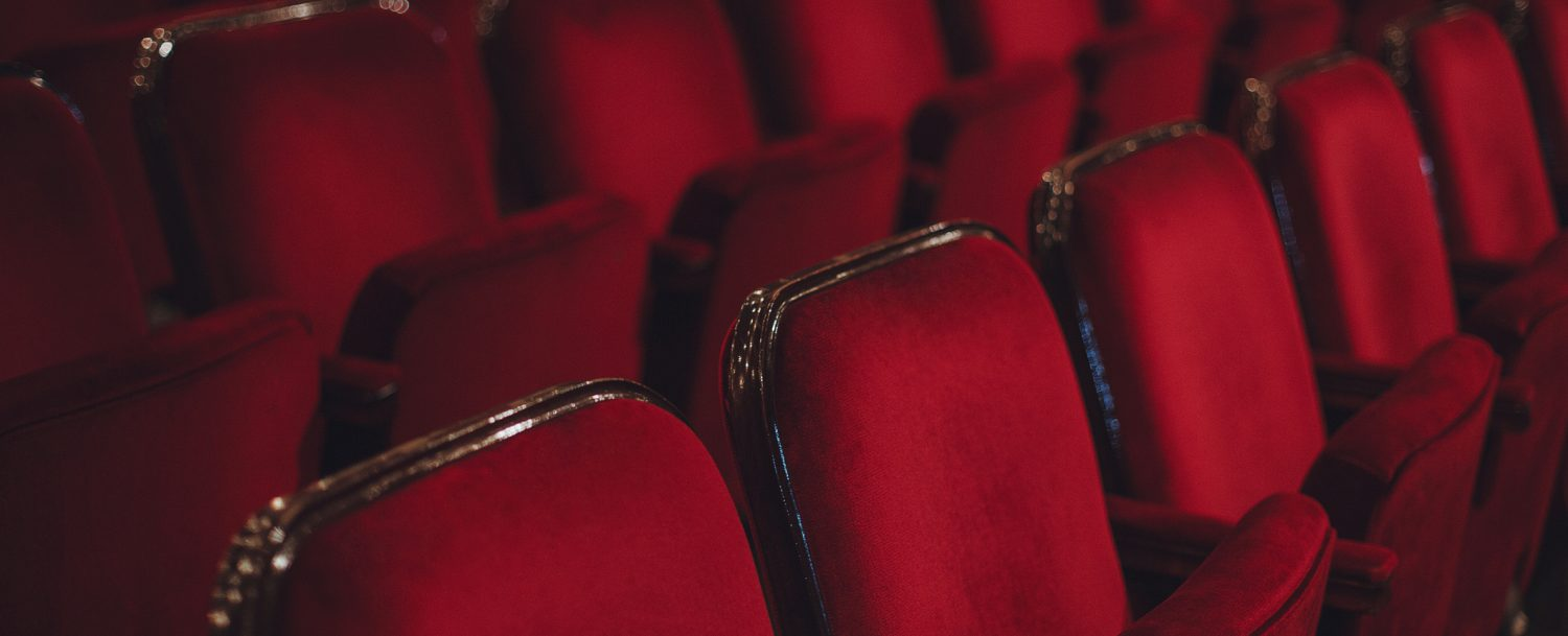 red, retro theater seats at the opera house.