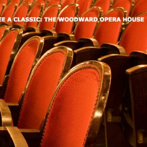 "A row or red velvet theater seats with the title, "" See a classic: The Woodward Opera House."""