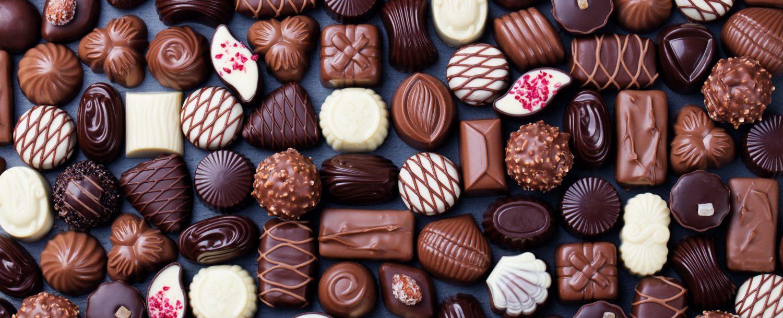 Assortment of fine chocolate candies, white, dark, and milk chocolate.