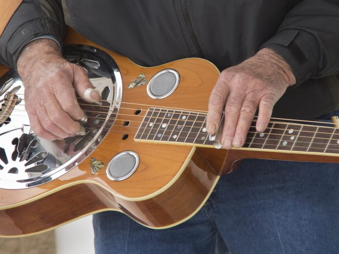 A muscian plays the Dobro in a Bluegrass Band at the Mohican Bluegrass Festival.