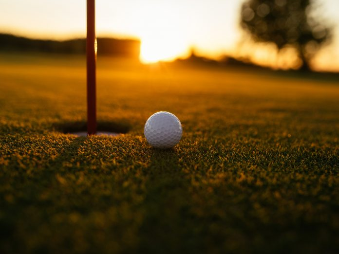 Shot of a golf ball on an empty course. Playing golf is one of the best things to do near Gambier, Ohio!