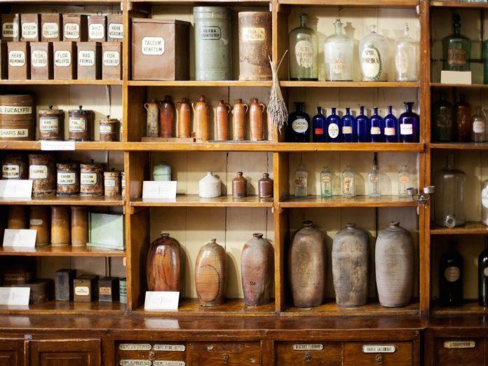 Bottles on shelf at an old pharmacy.